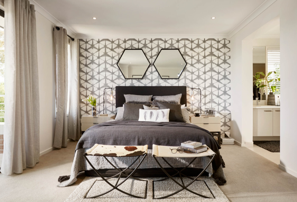 bedroom with two mirrors above bedhead
