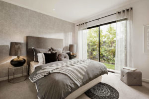 bedroom with tree views