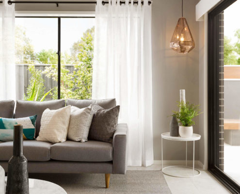 living room with lamp hanging in the corner