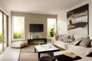 open plan living area with tv mounted on the wall