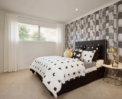 modern bedroom with tiled feature wall